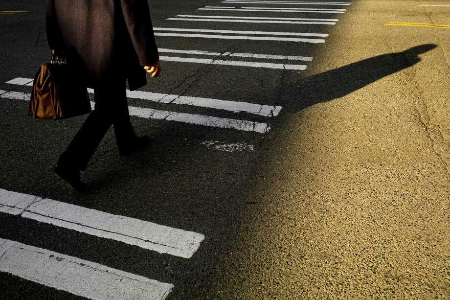 March, 22, 2013 — A man crosses the street in the Belltown neighborhood of Seattle. Photo: JORDAN STEAD, SEATTLEPI.COM / SEATTLEPI.COM