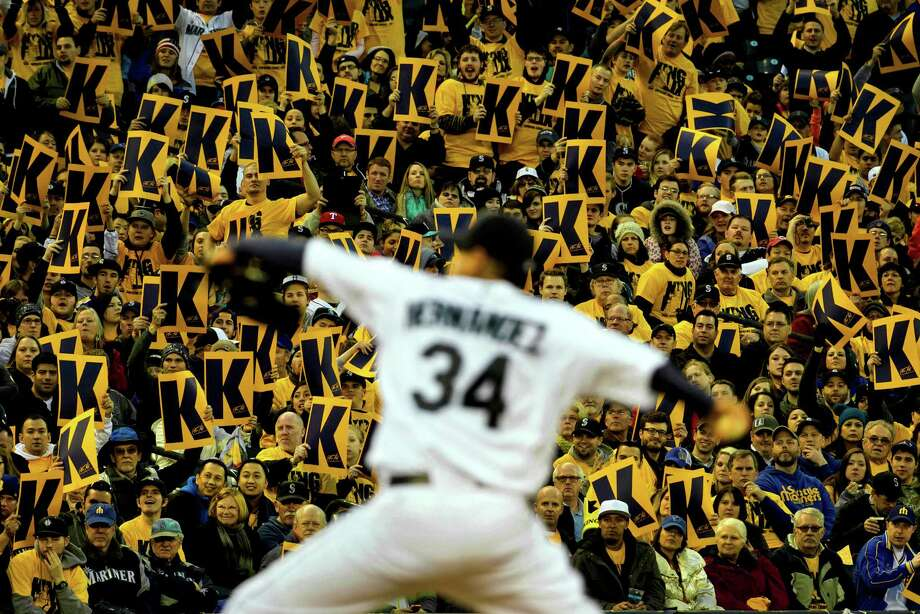 April 11, 2013— Backed by a sea of yellow King Felix signs, Mariners pitcher Felix Hernandez pitches during a game against the Texas Rangers at Safeco Field in Seattle. The Rangers beat the Mariners 4-3. The evening marked Hernandez's opening game pitching at home for the 2013 season. Photo: JORDAN STEAD, SEATTLEPI.COM / SEATTLEPI.COM