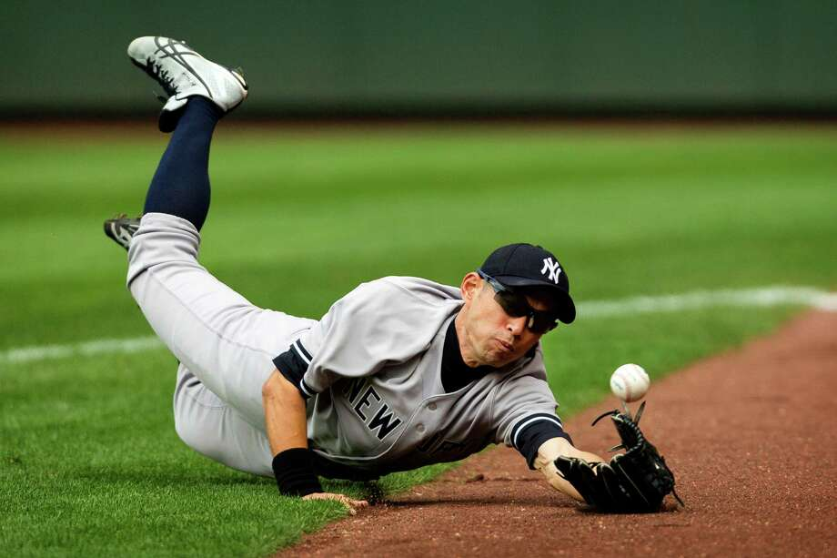 June 9, 2013 — Former-Mariner-turned-Yankee Ichiro Suzuki fumbles a foul ball during a game against the Mariners at Safeco Field in Seattle. Nearly 44,000 people attended the sunny day game, and the New York Yankees beat the Mariners 2-1. Photo: JORDAN STEAD, SEATTLEPI.COM / SEATTLEPI.COM
