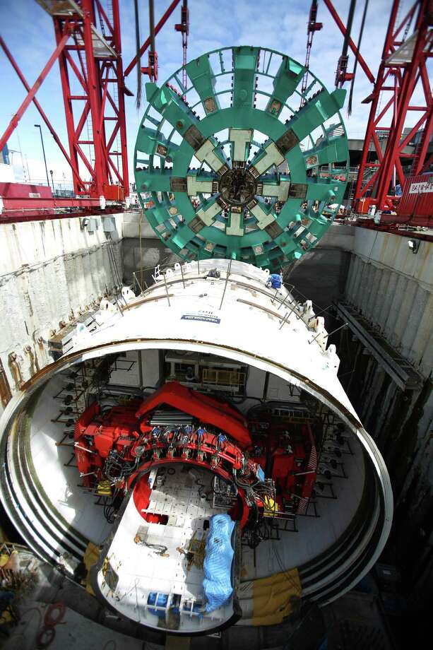 May 31, 2013 — The cutter head of the Washington State Department of Transportation's Big Bertha Highway 99 tunnel boring machine is lowered into its launch pit. The machine launched over the summer and was expected to emerge from the other end of the tunnel 14 months later. Photo: JOSHUA TRUJILLO, SEATTLEPI.COM / SEATTLEPI.COM
