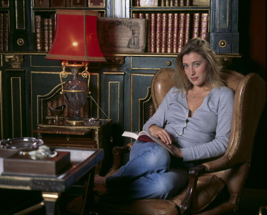 Valeria Bruni Tedeschi in her library, in December, 1990. Photo: AUGER Benjamin, Paris Match Via Getty Images / Paris Match Archive