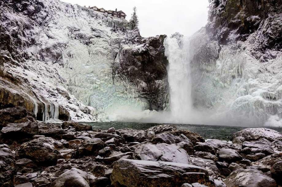 December 9, 2013 — A cold wave in Western Washington reduced Snoqualmie Falls to some world-class icicles. Officials at Puget Sound Energy say icy conditions such as these occur about once a year. The ice did not stop or hurt power production of the hydroelectric plant at the falls. Photo: JORDAN STEAD, SEATTLEPI.COM / SEATTLEPI.COM