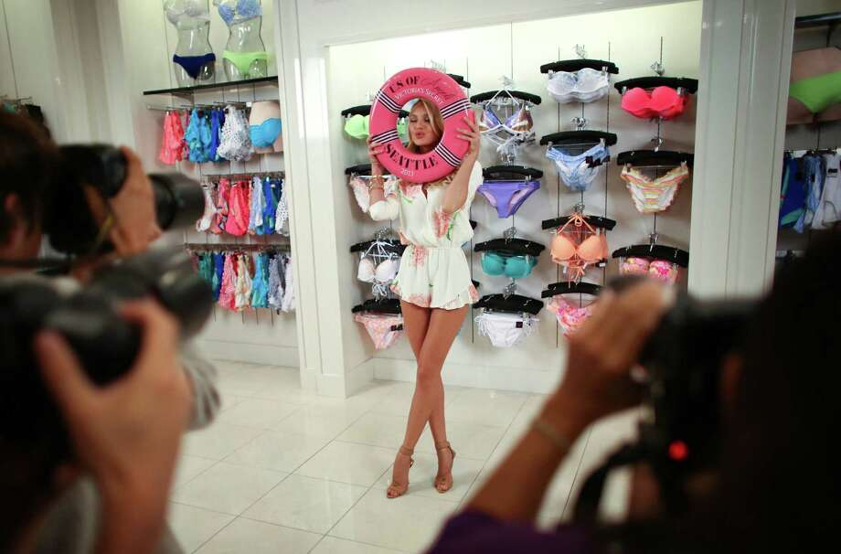 July 10, 2013 — Supermodel Candice Swanepoel poses for photographers in the Victoria's Secret store at Bellevue Square Mall. The Victoria's Secret model came to the local store after fans voted for three cities for the models to visit. The other winning cities in the promotion were Orlando and Milwaukee. Photo: JOSHUA TRUJILLO, SEATTLEPI.COM / SEATTLEPI.COM