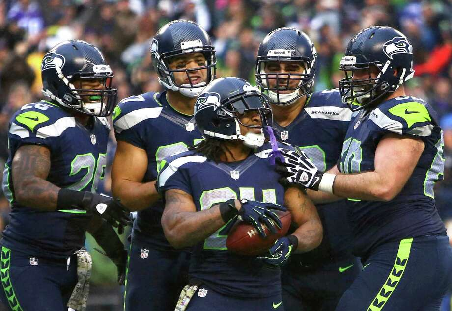 November 17, 2013— Seattle Seahawks player Marshawn Lynch is surrounded by teammates after a fourth quarter touchdown against the Minnesota Vikings at CenturyLink Field in Seattle. Photo: JOSHUA TRUJILLO, SEATTLEPI.COM / SEATTLEPI.COM