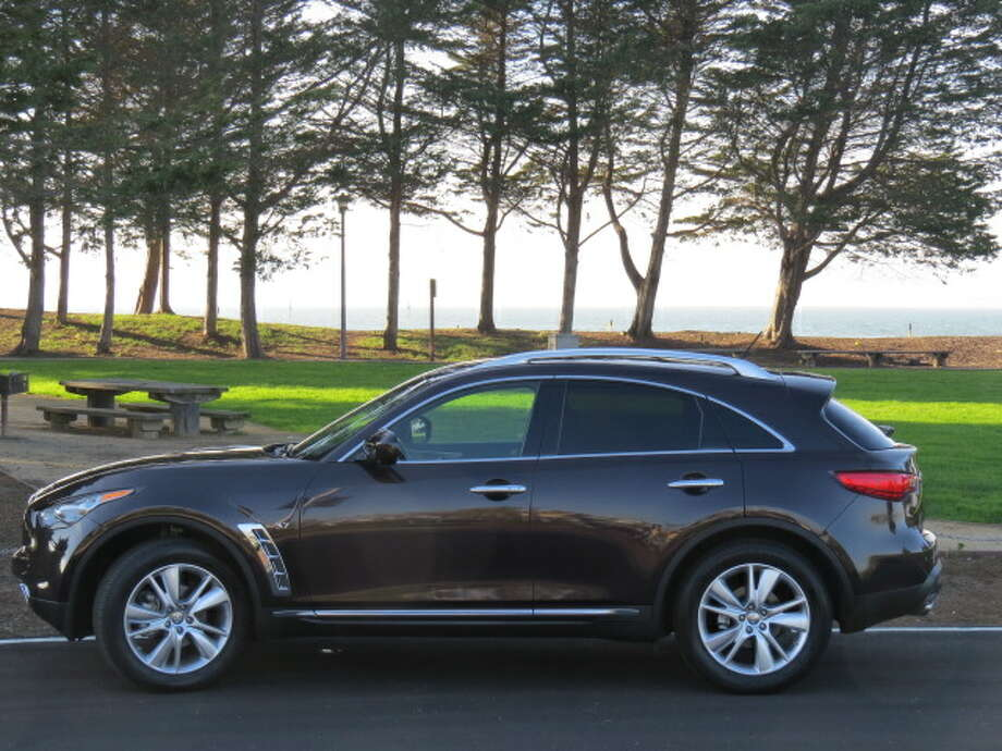 What makes the QX stand out is what I can only describe as its flowing, muscular lines. Look at how the front fenders bulge slightly – it's like Arnold Schwarzenegger in a $2,000 tuxedo, big shoulders expensively covered.