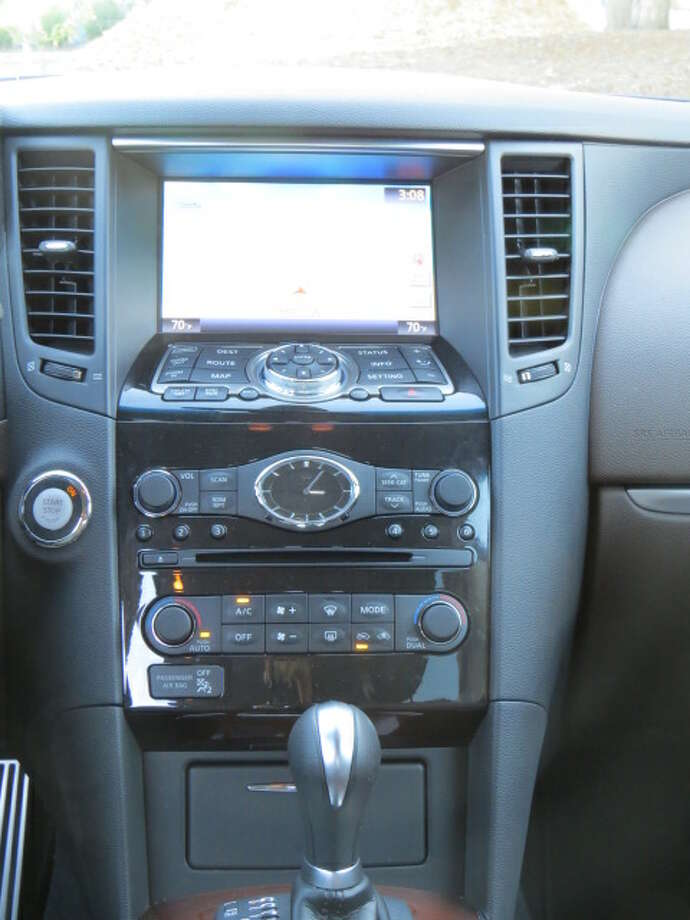 "The ""Premium Package"" option, with its premium price of $4,300, brings the more tangible goodies, such as navigation, ""Around View® Monitor with Moving Object Detection and Front and Rear Sonar,"" Bluetooth for streaming audio, the CD/DVD in-dash player, tilt-telescoping steering column and on and on until the electrons fade into the sunset."