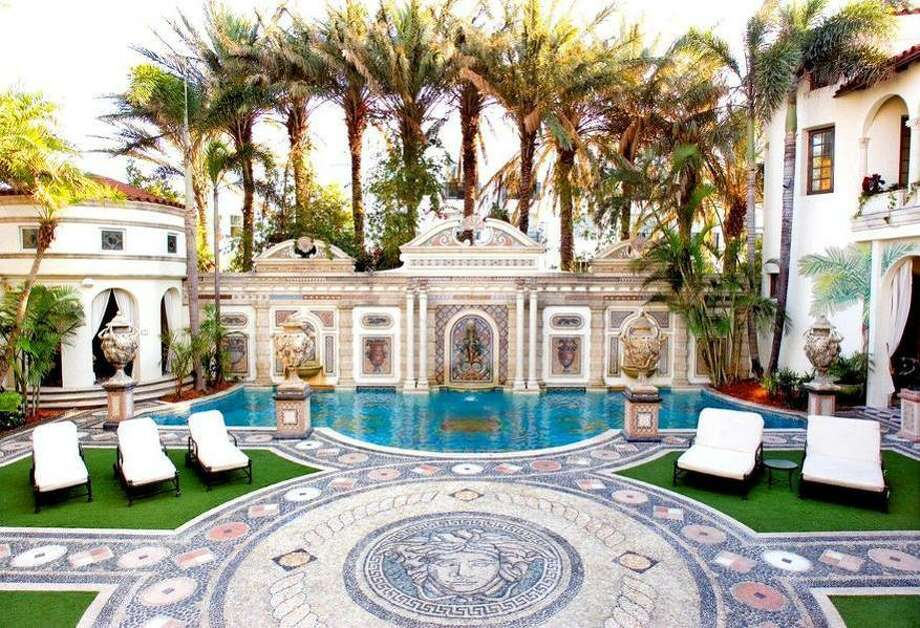 Versace's mansion traded hands by auction for $41.5M (way less than its original list of $125M).  Purchased by the same folks who own Jordache Jeans, the property was in foreclosure; now, the purchasers plan to make it a hotel. Photo: Photo Via Yahoo Homes