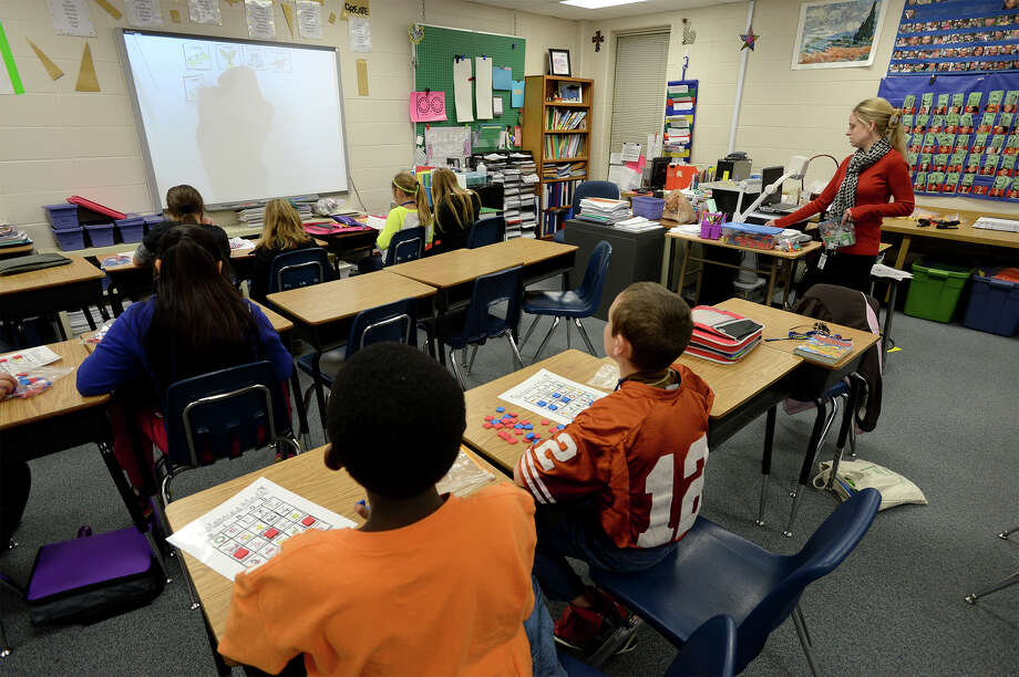 Amy Pelt substitutes a fourth grade math class at the Hamshire-Fannett Intermediate School on Friday. The public school is the newest to allow students to transfer from outside of the district.   Photo taken Friday, December 12, 2013 Guiseppe Barranco/@spotnewsshooter Photo: Guiseppe Barranco, Photo Editor