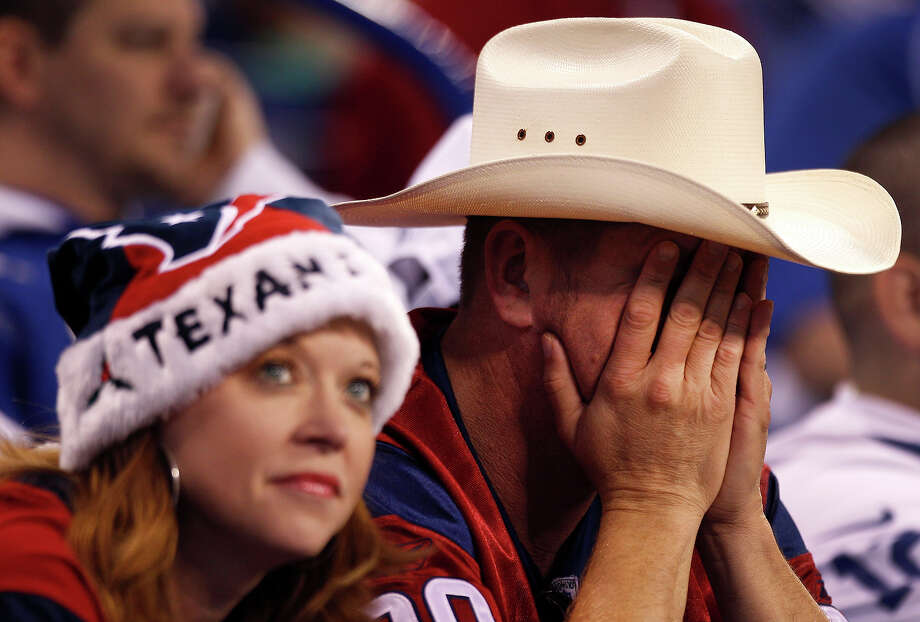 A pair of Houston Texans fans react to the poor showing by the Texans against the Indianapolis Colts during the fourth quarter of an NFL football game at Lucas Oil Stadium Sunday, Dec. 15, 2013, in Indianapolis. Photo: Brett Coomer, Houston Chronicle / © 2013  Houston Chronicle
