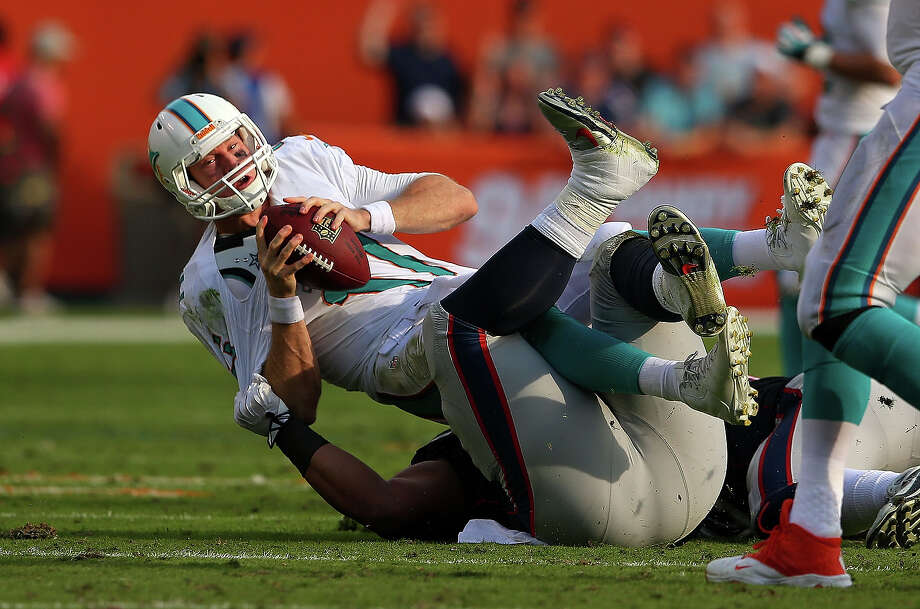 Ryan Tannehill #17 of the Miami Dolphins is sacked by Sealver Siliga #71 of the New England Patriots during a game  at Sun Life Stadium on December 15, 2013 in Miami Gardens, Florida. Photo: Mike Ehrmann, Getty Images / 2013 Getty Images