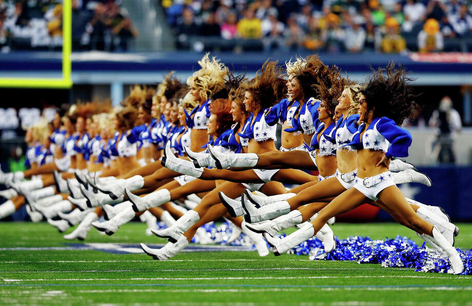 Dallas Cowboys cheerleaders perform prior to a game against the Green Bay Packers at AT&T Stadium on December 15, 2013 in Arlington, Texas. Photo: Tom Pennington, Getty Images / 2013 Getty Images