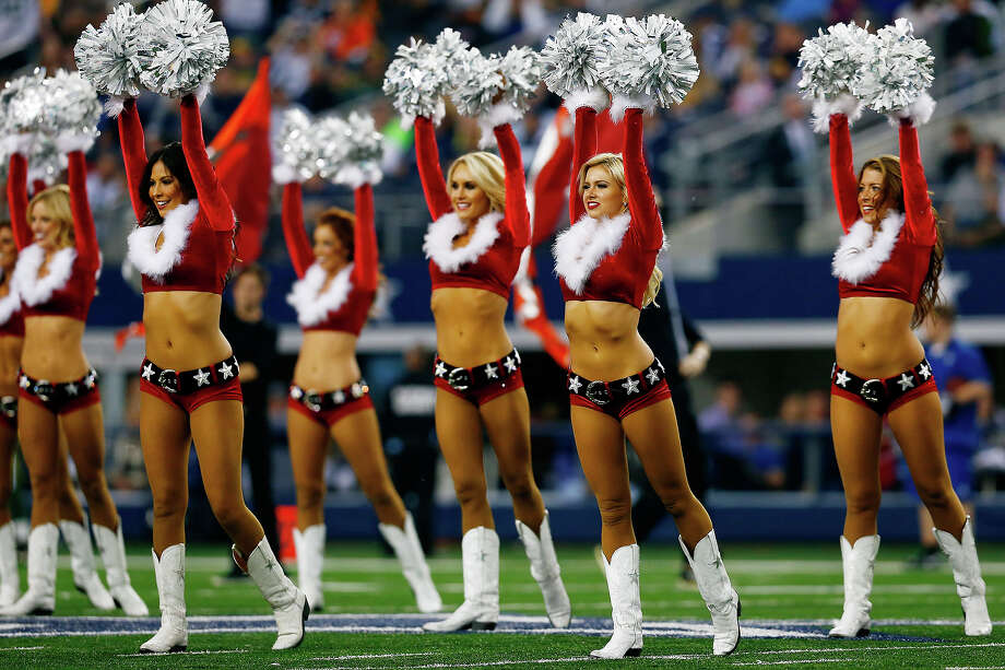Dallas Cowboys cheerleaders perform at halftime during a game against the Green Bay Packers at AT&T Stadium on December 15, 2013 in Arlington, Texas. Photo: Tom Pennington, Getty Images / 2013 Getty Images