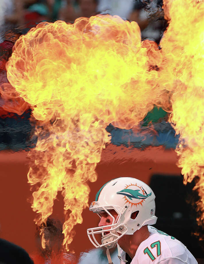 Dolphins quarterback Ryan Tannehill was hot as he ran through the pre-game pyrotechnic display as he was introduced, and he would get hot again, as he led Miami to a game winning touchdown drive late in the fourth quarter that propelled Miami to a 24-20 victory over the Patriots. The New England Patriots visited the Miami Dolphins in a regular season NFL game at Sun Life Stadium. Photo: Boston Globe, Boston Globe Via Getty Images / 2013 - The Boston Globe - The Boston Globe