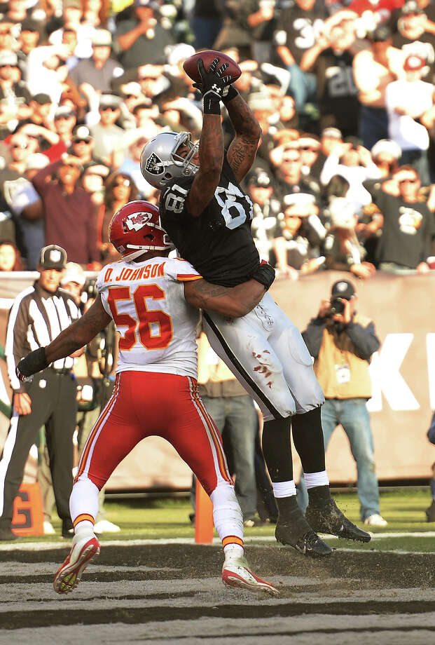 Mychal Rivera #81 of the Oakland Raiders catches a fourteen yard touchdown pass over Derrick Johnson #56 of the Kansas City Chiefs during the third quarter at O.co Coliseum on December 15, 2013 in Oakland, California. The Chiefs won the game 56-31. Photo: Thearon W. Henderson, Getty Images / 2013 Thearon W. Henderson