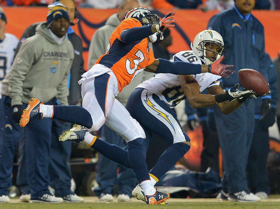 San Diego Chargers wide receiver Vincent Brown (86) catches a pass against Denver Broncos cornerback Kayvon Webster (36) in the third quarter of an NFL football game, Thursday, Dec. 12, 2013, in Denver. Photo: Jack Dempsey, AP / FR42408 AP