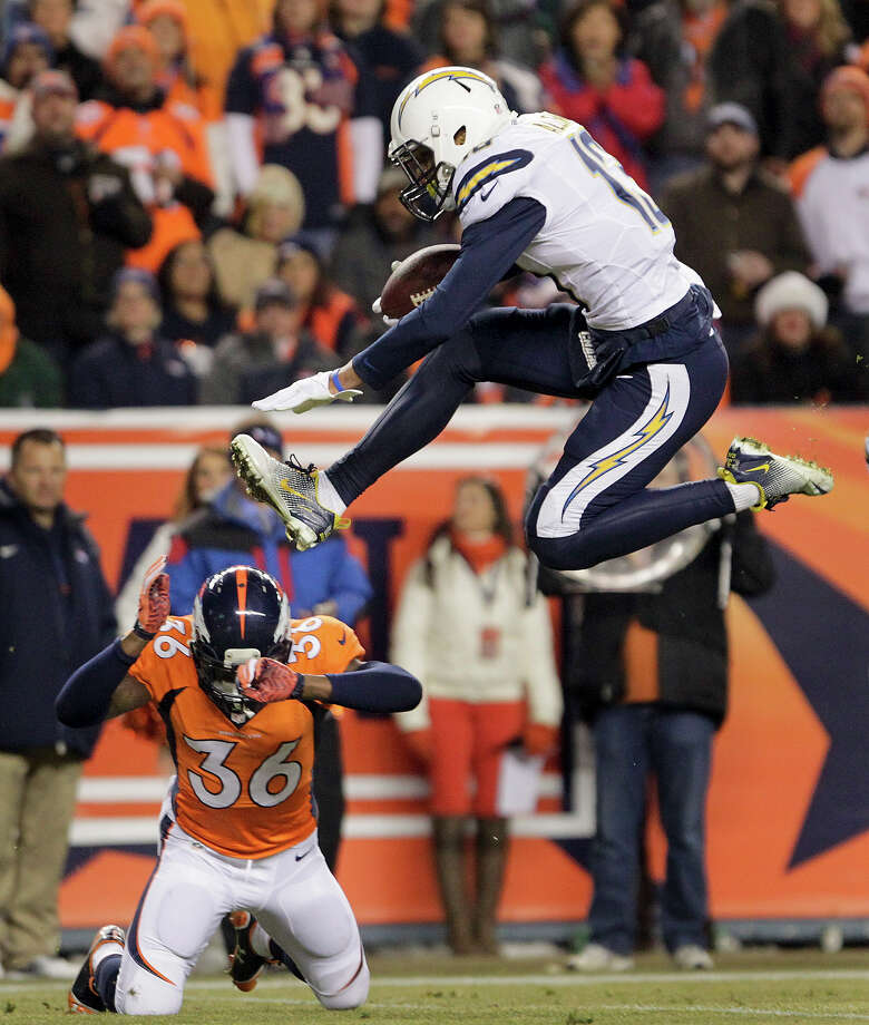 San Diego Chargers wide receiver Keenan Allen (13) leaps over Denver Broncos cornerback Kayvon Webster (36) on his way to the end zone for a touchdown in the second quarter of an NFL football game, Thursday, Dec. 12, 2013, in Denver. Photo: Joe Mahoney, ASSOCIATED PRESS / AP2013
