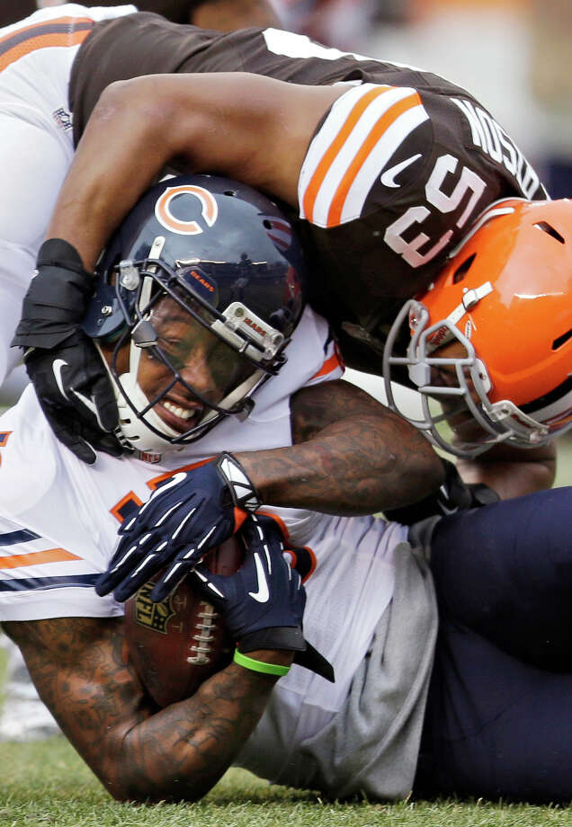Chicago Bears wide receiver Brandon Marshall (15) is tackled by Cleveland Browns inside linebacker Craig Robertson (53) after a catch in the first quarter of an NFL football game, Sunday, Dec. 15, 2013, in Cleveland. Photo: Tony Dejak, AP / AP