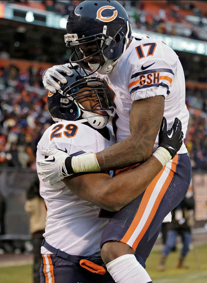 Chicago Bears running back Michael Bush (29) celebrates with wide receiver Alshon Jeffery (17) after Bush ran 40 yards for a touchdown against the Cleveland Browns in the fourth quarter of an NFL football game Sunday, Dec. 15, 2013, in Cleveland. The Bears won 38-31. Photo: Tony Dejak, AP / AP