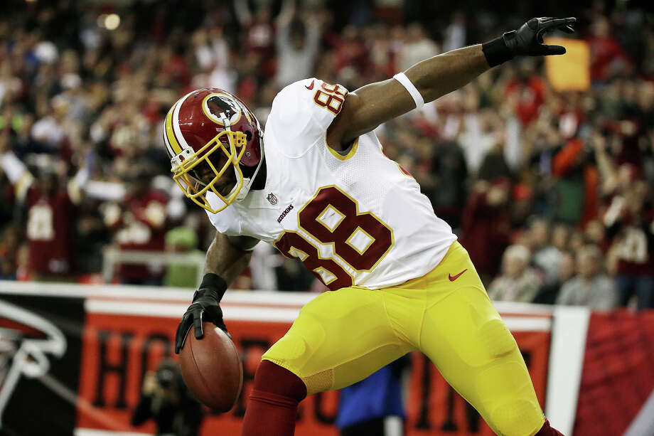 Washington Redskins wide receiver Pierre Garcon (88) celebrates his touchdown against the Atlanta Falcons during the first half of an NFL football game, Sunday, Dec. 15, 2013, in Atlanta. Photo: David Goldman, ASSOCIATED PRESS / AP2013