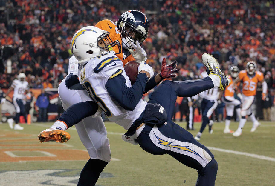San Diego Chargers wide receiver Keenan Allen (13) catches a pass for a touchdown against Denver Broncos cornerback Kayvon Webster (36) in the second quarter of an NFL football game, Thursday, Dec. 12, 2013, in Denver. Photo: Joe Mahoney, ASSOCIATED PRESS / AP2013