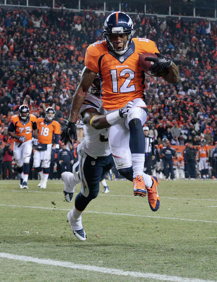 Denver Broncos wide receiver Andre Caldwell (12) leaps over the goal line for a touchdown against San Diego Chargers defensive back Jahleel Addae (37) in the fourth quarter of an NFL football game, Thursday, Dec. 12, 2013, in Denver. Photo: Joe Mahoney, ASSOCIATED PRESS / AP2013