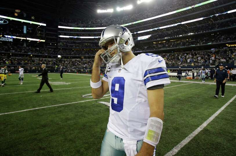 Dallas Cowboys quarterback Tony Romowalks off the field after the 37-36 loss to the Green Bay Packer