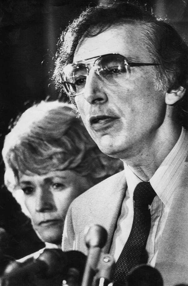 Dr. Robert Gallo, chief of the National Cancer Institute laboratory of Tumor Cell Biology, along with Health and Human Services secretary Margaret Heckler talks to reporters in Washington on April 23, 1984, where they announce that the probable cause of Acquired Immune Deficiency Syndrom (AIDS) has been found, a cancer virus called HTLV-3. Photo: LANA HARRIS, Associated Press / AP1984
