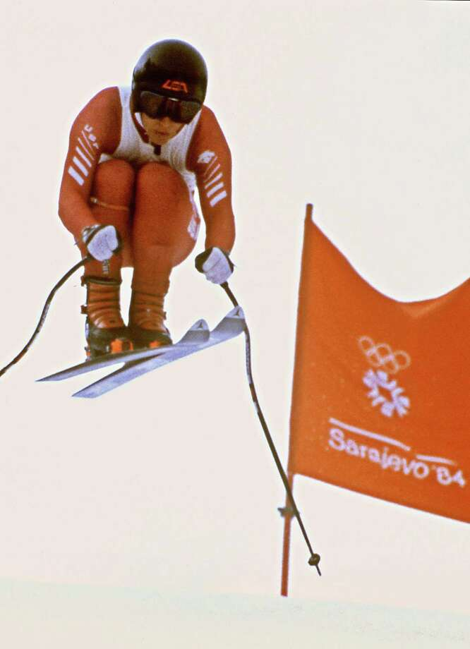Bill Johnson jumps past a gate on his way to becoming the first American to win a gold medal in downhill skiing during the men's downhill on Feb. 16, 1984, in Sarajevo at the Winter Olympic Games. Johnson won the gold medal in front of Swiss Peter Müller (silver) and Austrian Anton Steiner (bronze). Photo: STAFF, Getty Images / 2012 AFP