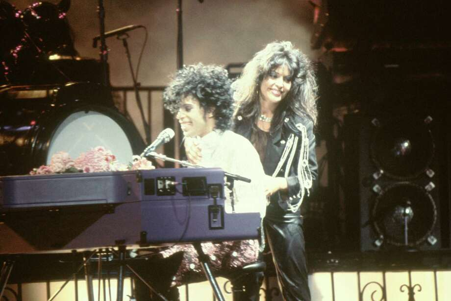 Prince performs on stage during the Purple Rain Tour with Apollonia Kotero, 1984.Related Slideshow: More movies turning 30 in 2014 Photo: Richard E. Aaron, Getty Images / Redferns