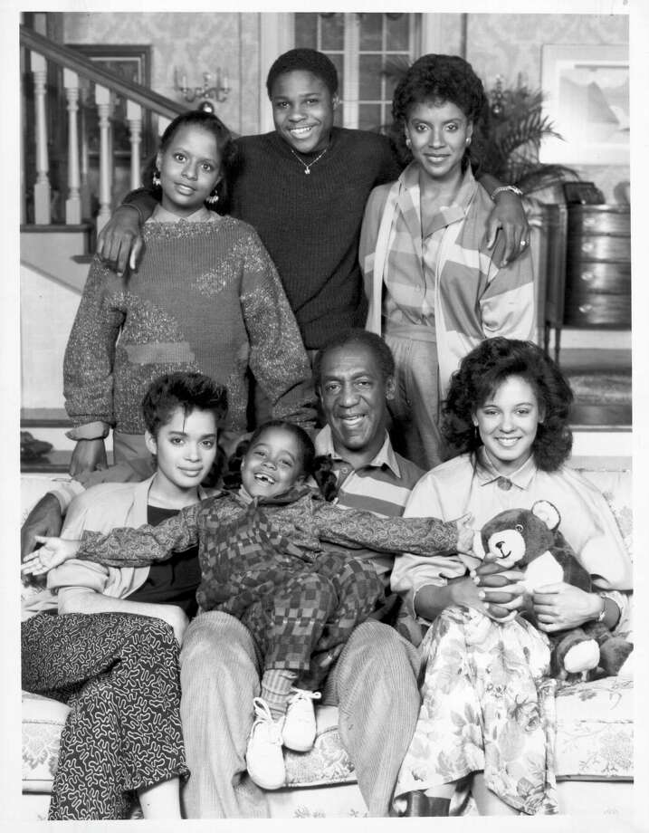 "The cast of ""The Cosby Show"" is seen in this photo from Sept. 13, 1985. Front row, left to right: Lisa Bonet, Bill Cosby, Keshia Knight Pulliam and Phylicia Ayers-Allen; Back row, left to right: Sabrina Le Beauf, Tempestt Bledsoe and Malcolm-Jamal Warner. Photo: Michael Ochs Archives, Getty Images / Michael Ochs Archives"