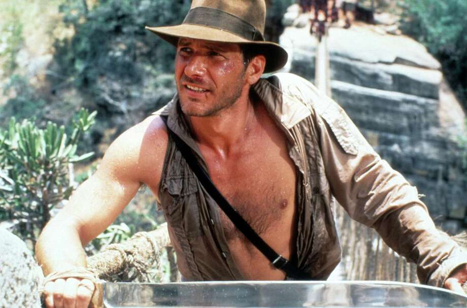 "Harrison Ford in a scene from the film ""Indiana Jones and the Temple of Doom,"" 1984.Related Slideshow: More movies turning 30 in 2014 Photo: Paramount Pictures, Getty Images / 2012 Getty Images"