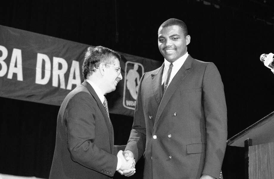 NBA Commissioner David Stern shakes Charles Barkley's hand, June 19, 1984, in New York City after the former Auburn University forward was drafted by the Philadelphia 76ers. The 1984 NBA Draft also included greats Michael Jordan and Hakeem Olajuwon. Photo: Marty Lederhandler, Associated Press / AP1984