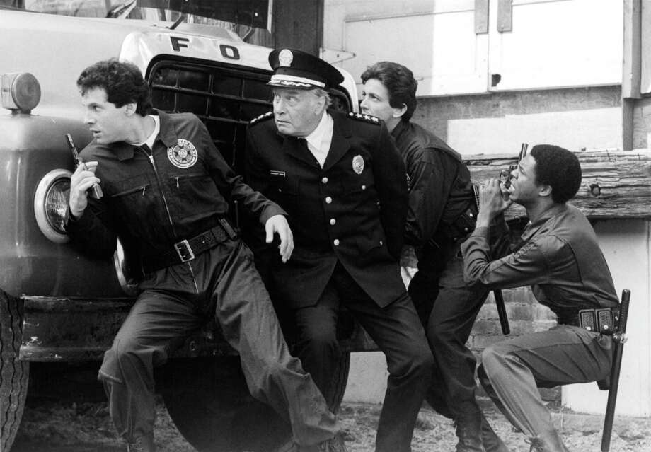 "Steve Guttenberg, George Gaynes, Andrew Rubin and Michael Winslow pursue a criminal in a scene from the film ""Police Academy,"" 1984. Photo: Warner Bros., Getty Images / 2013 Getty Images"
