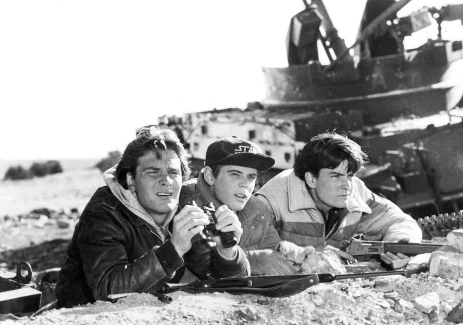 "In this 1984 file photo, actors Patrick Swayze (from left), C. Thomas Howell and Charlie Sheen are shown in a scene from the film ""Red Dawn."" Photo: MGM/United Artists, Getty Images / MGM/United Artists"