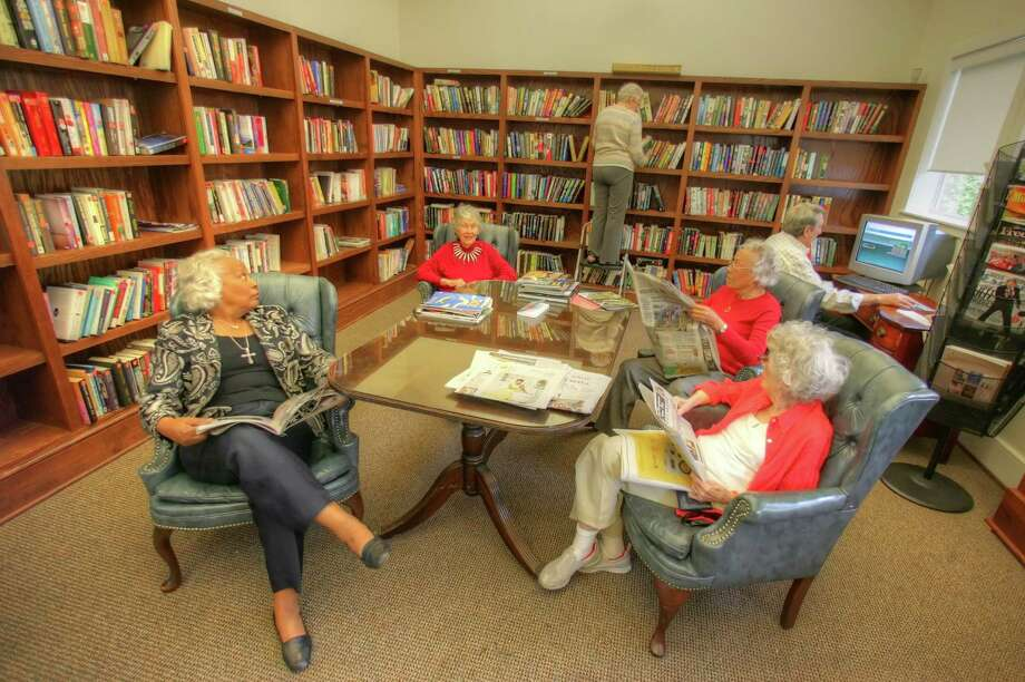 The library at Holly Hall sees a lot of traffic with the residents enjoying all it has to offer.