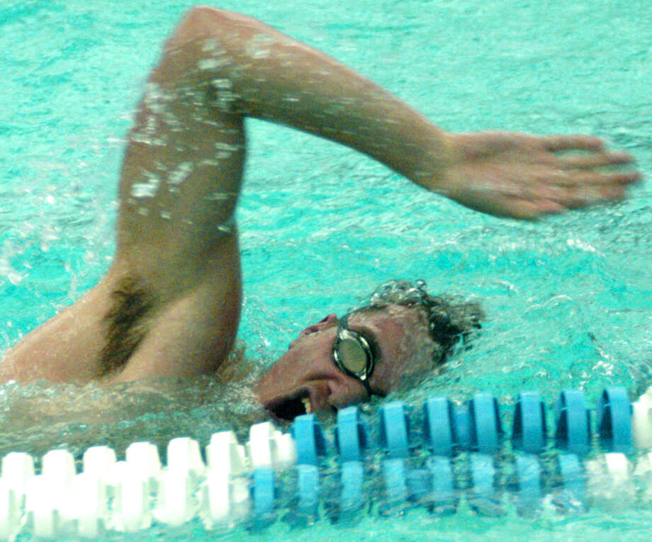 The Green Wave's Wade Elsesser churns out the laps during New Milford High School boys' swim practice at Canterbury School, Dec. 11, 2013 Photo: Norm Cummings / The News-Times