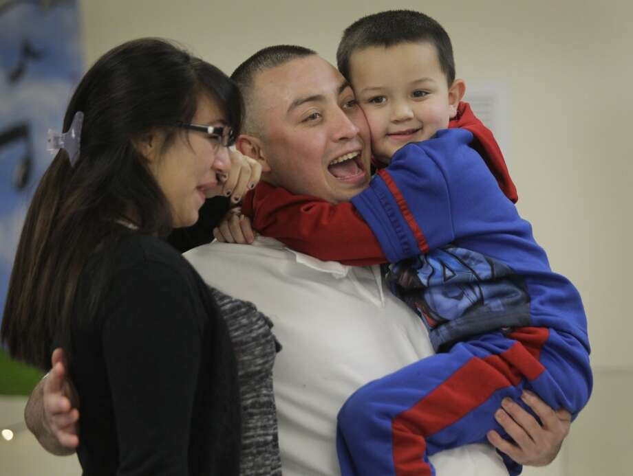 Inmate Daniel Ortega hugs his children, Alyssa Tate, 14, and Daniel Ortega after arriving for the Angel Tree program Christmas party at Texas Department of Criminal Justice Carol Vance Unit Saturday, Dec. 7, 2013, in Richmond. ( Melissa Phillip / Houston Chronicle ) Photo: Melissa Phillip, Houston Chronicle