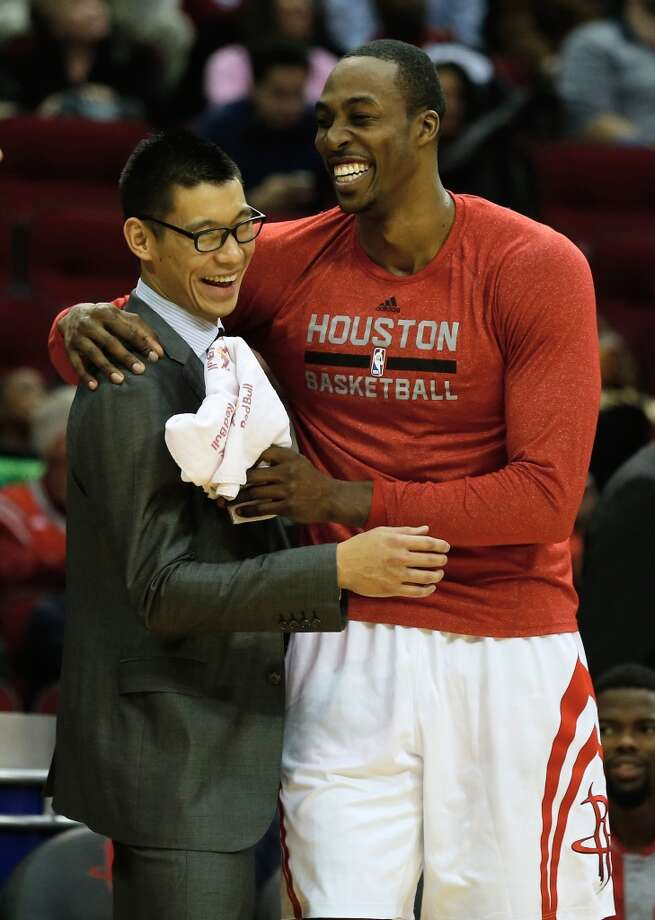 HOUSTON, TX - DECEMBER 08:   Dwight Howard #12 hugs Jeremy Lin #7 of the Houston Rockets during a timeout during the game against the Orlando Magic at Toyota Center on December 8, 2013 in Houston, Texas. NOTE TO USER: User expressly acknowledges and agrees that, by downloading and or using this photograph, User is consenting to the terms and conditions of the Getty Images License Agreement. (Photo by Scott Halleran/Getty Images) Photo: Scott Halleran, Getty Images