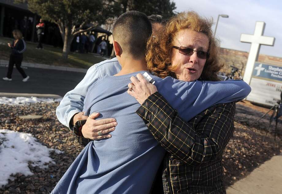 CENTENNIAL, CO - DECEMBER 13:  JoAnne Allen, right, hugs her son Alex Allen, 17, after a school shooting on December 13, 2013 at Arapahoe High School in Centennial, Colorado. According to authorities, two students were injured by a lone gunman who later died of a self-inflicted gun shot wound. (Photo by Chris Schneider/Getty Images) *** BESTPIX *** Photo: Chris Schneider, Getty Images
