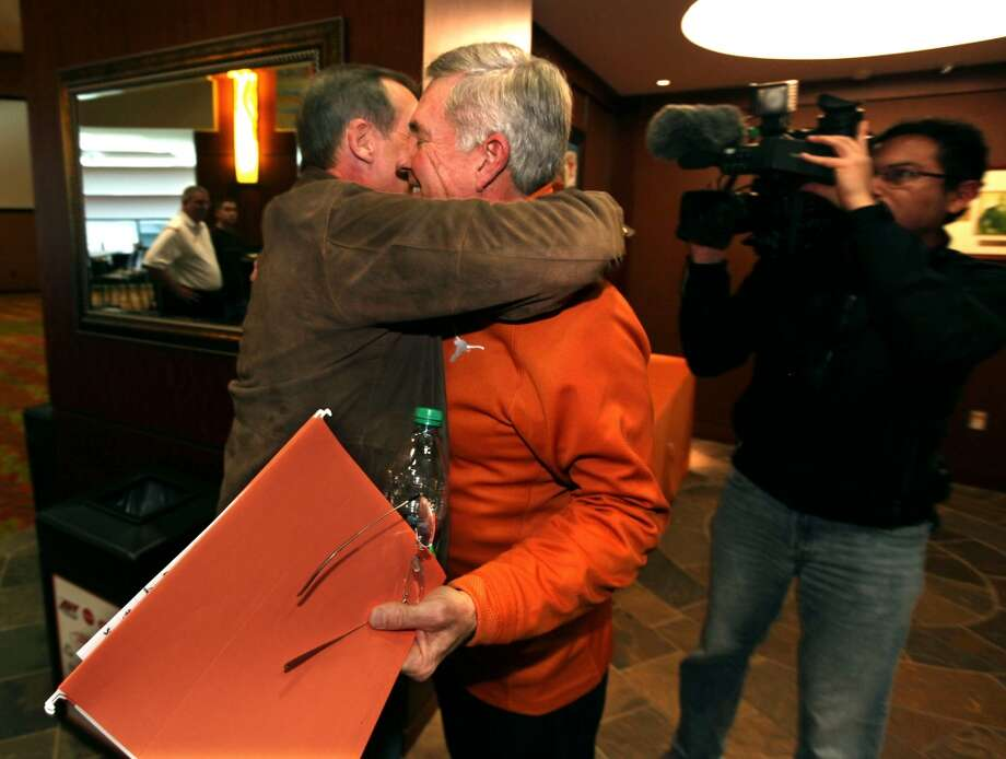 AUSTIN, TX - DECEMBER 15: University of Texas head football coach Mack Brown (R) gets a hug from Texas basketball coach Rick Barnes after speaking at a press conference December 15, 2013 in Austin, Texas. Brown announced that he will step down as coach after the Valero Alamo Bowl game against Oregon on December 30. (Photo by Erich Schlegel/Getty Images) Photo: Erich Schlegel, Getty Images