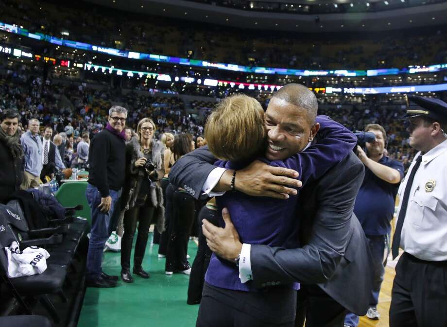 Doc Rivers, former head coach of the Boston Celtics and current head coach of the Los Angeles Clippers, hugs a well-wisher as he enters the TD Garden floor for his first time back, before an NBA basketball game in Boston, Wednesday, Dec. 11, 2013. (AP Photo/Elise Amendola) Photo: Elise Amendola, Associated Press