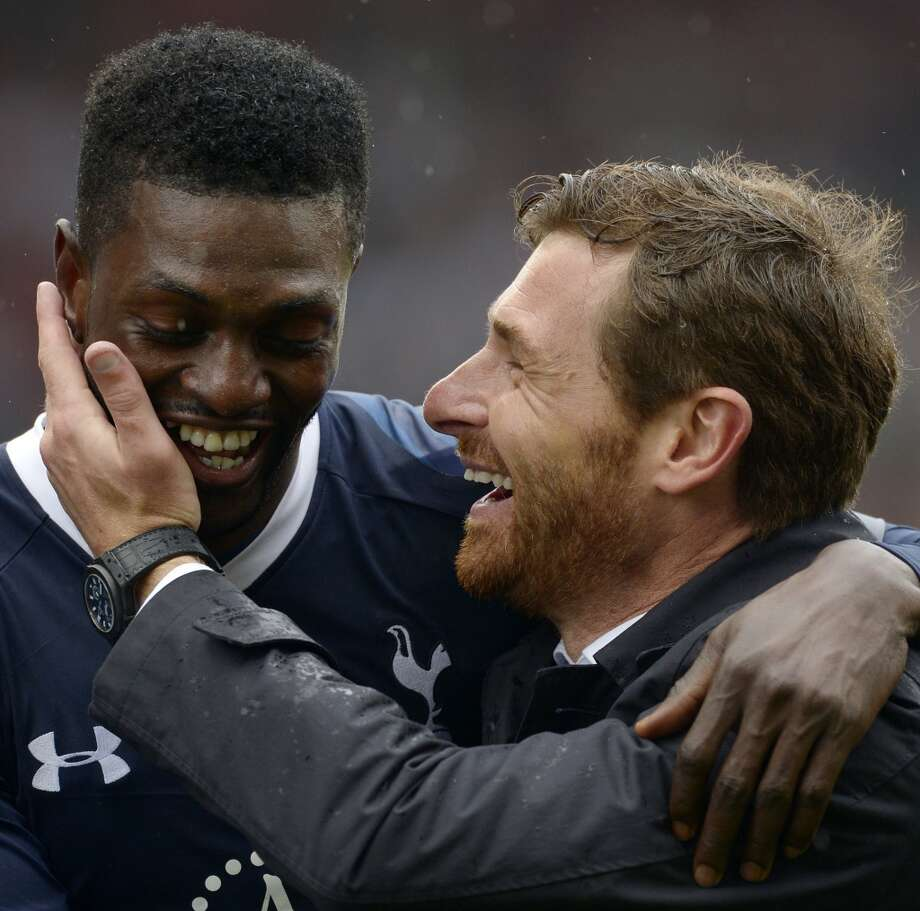 (FILES) In this file picture taken on May 12, 2013 Tottenham Hotspur's Portuguese manager Andre Villas-Boas (R) hugs Tottenham Hotspur's Togolese striker Emmanuel Adebayor (L) at the end of the English Premier League football match between Stoke City and Tottenham Hotspur at the Britannia Stadium in Stoke on Trent, central England.  Andre Villas-Boas has been sacked as manager of Tottenham Hotspur, the English Premier League club announced on December 16, 2013. AFP PHOTO / ADRIAN DENNIS  RESTRICTED TO EDITORIAL USE. No use with unauthorized audio, video, data, fixture lists, club/league logos or live services. Online in-match use limited to 45 images, no video emulation. No use in betting, games or single club/league/player publications.ADRIAN DENNIS/AFP/Getty Images Photo: ADRIAN DENNIS, AFP/Getty Images