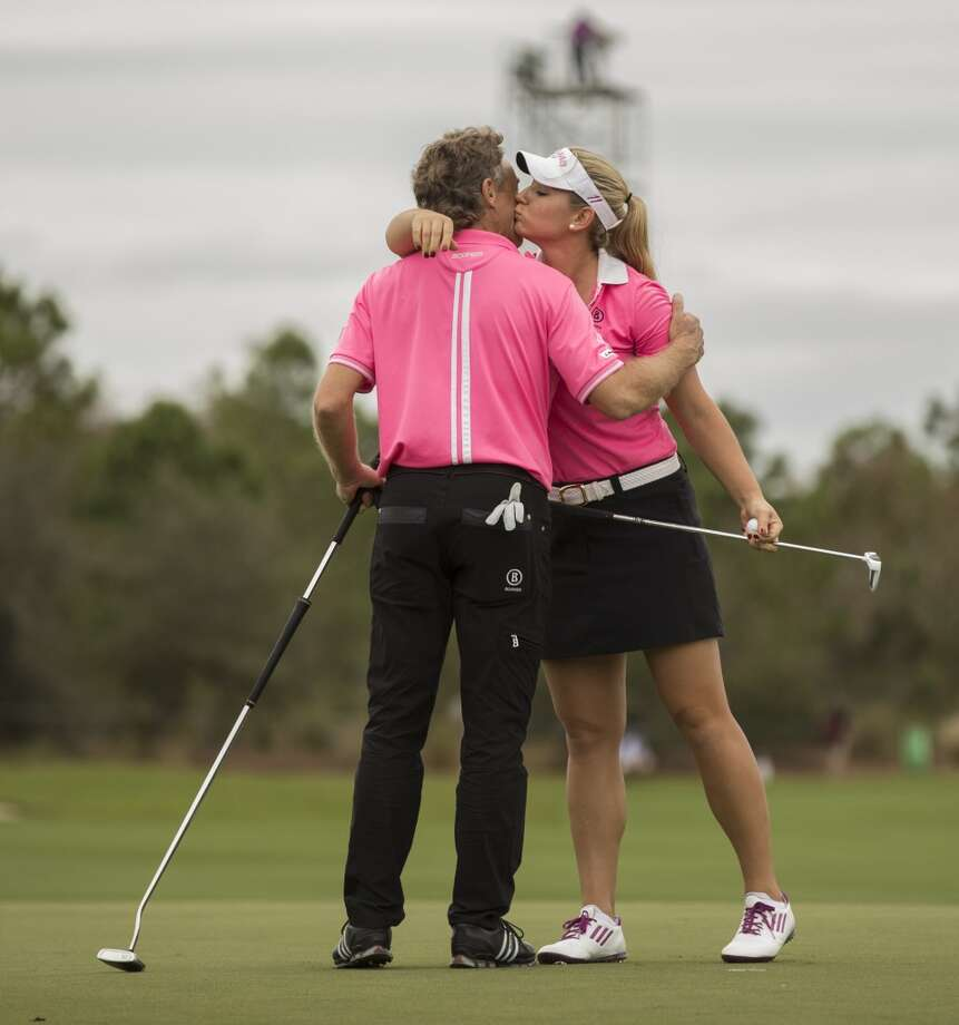 Bernhard Langer gives his daughter Christina Langer a hug on the 18th hole during the Father-Son Challenge at the Ritz-Carlton Golf Club in Orlando, Fla., Sunday, Dec. 15, 2013. (AP Photo/Willie J. Allen Jr.) Photo: Willie J. Allen, Jr., Associated Press