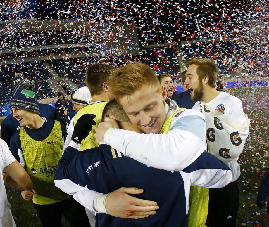 Notre Dame goalkeeper Patrick Wall, right, hugs a teammate after defeating Maryland 2-1 during the championship game of the NCAA Division 1 Men's Soccer tournament at PPL Park in Chester, Pa., Sunday, Dec. 15, 2013. (AP Photo/Rich Schultz) Photo: RICH SCHULTZ, Associated Press
