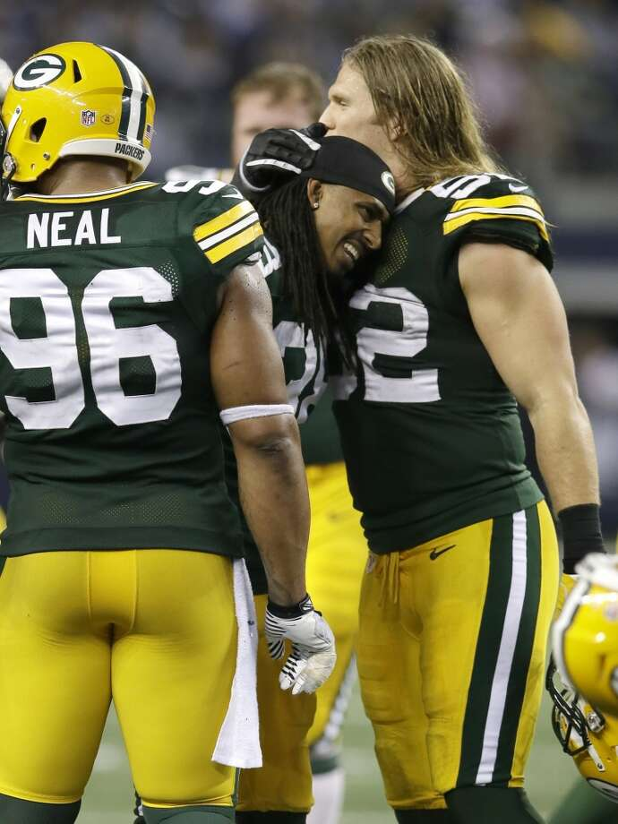 Green Bay Packers cornerback Tramon Williams (38) gets a hug from teammate Clay Matthews (52) as Mike Neal (96) looks on after an NFL football game against the Dallas Cowboys Sunday, Dec. 15, 2013, in Arlington, Texas. (AP Photo/Tony Gutierrez) Photo: Tony Gutierrez, Associated Press