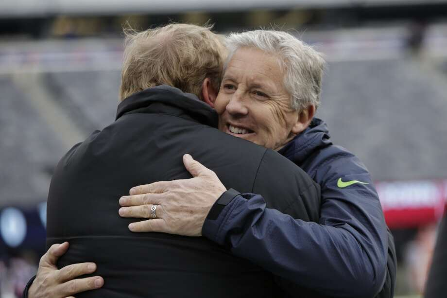 Seattle Seahawks head coach Pete Carroll, right, hugs NFL commissioner Roger Goodell before an NFL football game against the New York Giants, Sunday, Dec. 15, 2013, in East Rutherford, N.J. (AP Photo/Kathy Willens) Photo: Kathy Willens, Associated Press