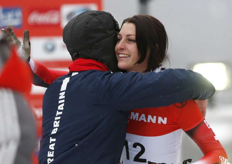 Austria's Janine Flock, right, hugs Great Britain's Elizabeth Yarnold after her run in the women's skeleton World Cup event on Sunday, Dec. 15, 2013, in Lake Placid, N.Y. Yarnold won the event and Flock finished second. (AP Photo/Mike Groll) Photo: Mike Groll, Associated Press