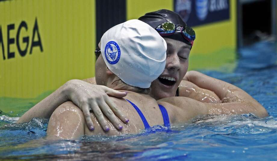 Katie Ledecky, left, gets a hug from Missy Franklin after competing in the women's 500-yard freestyle race during final round at the USA Swimming winter national championships at Allan Jones Intercollegiate Aquatic Center on Thursday, Dec. 5, 2013, in Knoxville, Tenn. (AP Photo/Wade Payne) Photo: Wade Payne, Associated Press