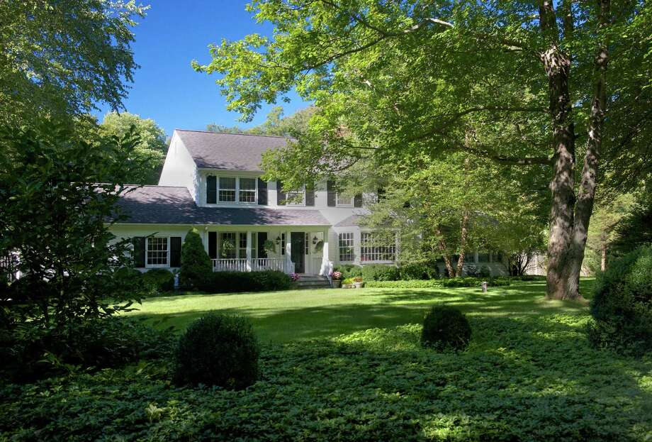 "The Colonial at 40 Sheridan Drive in New Canaan was picked by Architectural Digest magazine as a 2013 ""inspiring makeover."" It is on the market for $1,995,000. Photo: Contributed Photo, Contributed / New Canaan News Contributed"