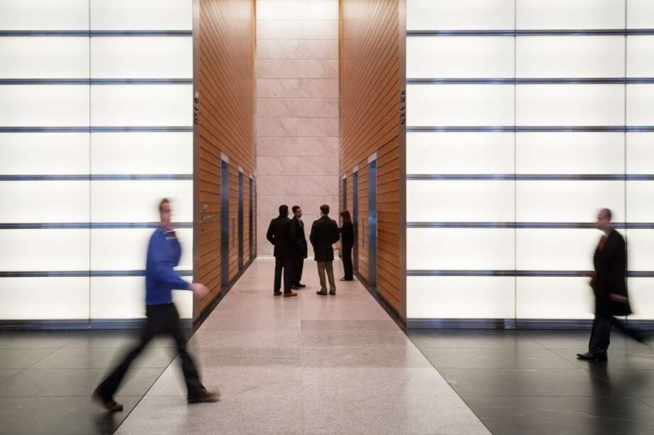 People walk through the front lobby of the BG Group Place at 811 Main St, Wednesday, Dec. 11, 2013, in Houston.  The building is one of several real estate developments that are finalists in the Urban Land Institutes's 2013 Development of Distinction Awards. Photo: Michael Paulsen, Houston Chronicle